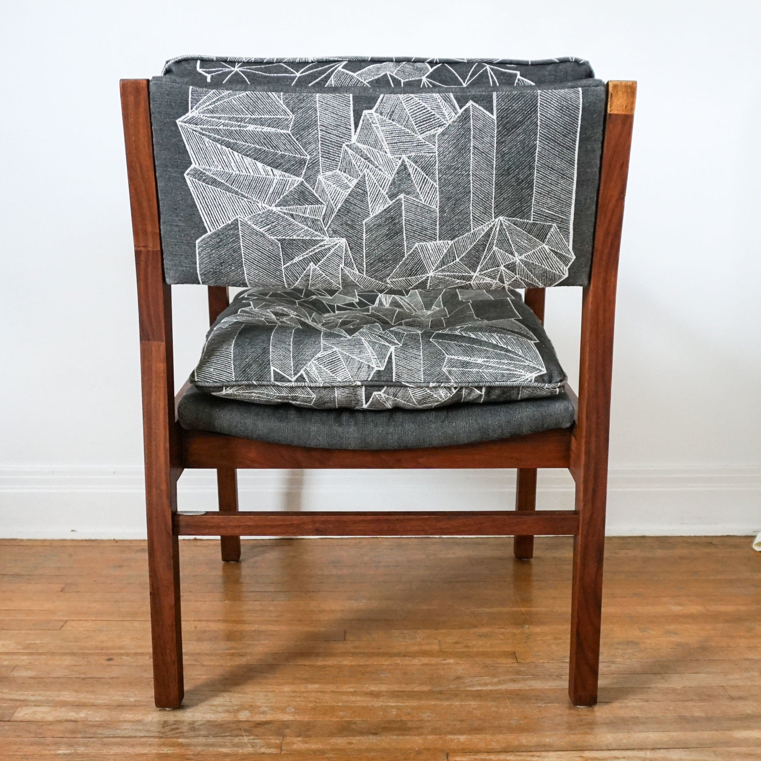 No mistake how this print looks like from the back, the placement nicely frames the different shapes.  Click through to get your own Downtown Sprawl Chair!