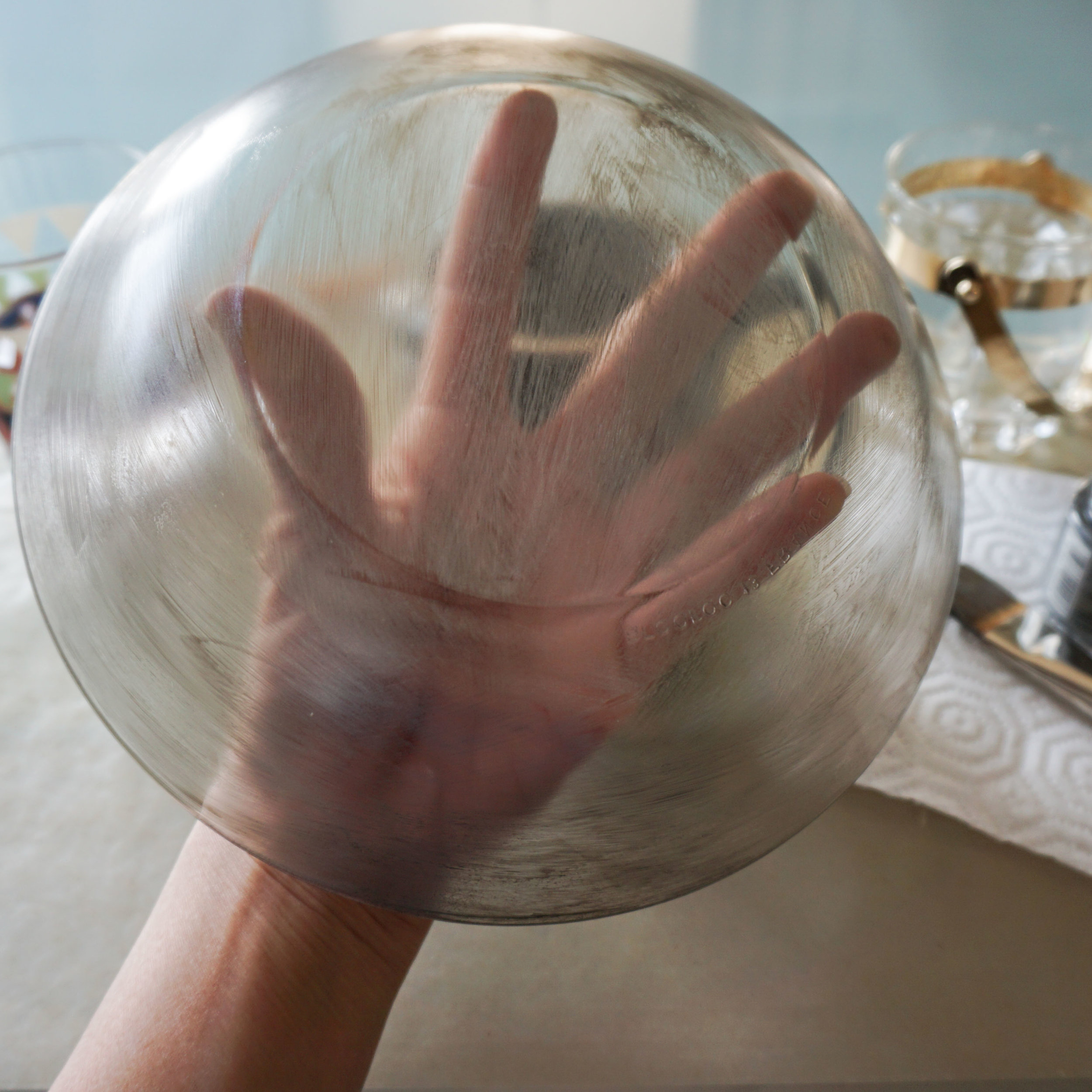 The wrist is a natural pivot for rotating and angling the dish.