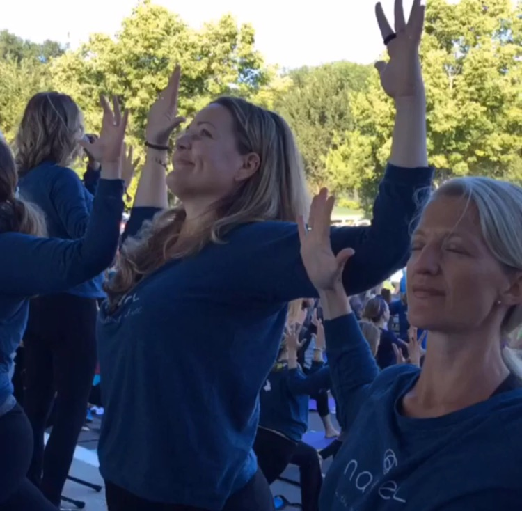 Yoga with hundreds of mama's together at the 2016 Bellyrama Event.