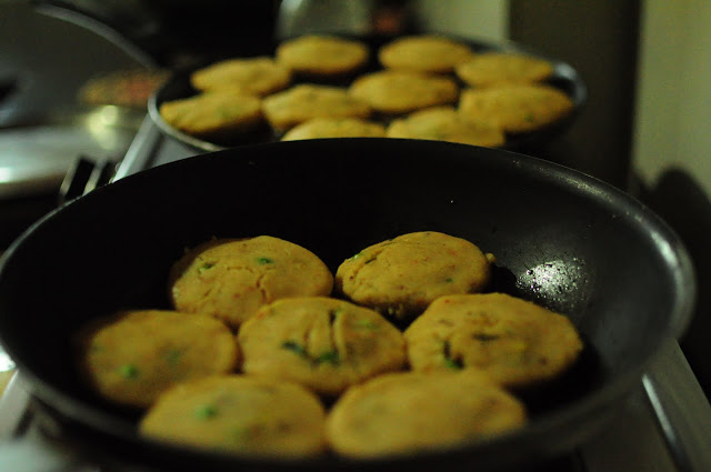 On a shallow pan with little Olive Oil and a very low heat start to cook the tikkis