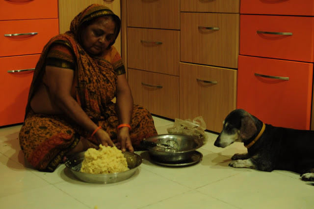 Pepper overlooking dadi mashing the potatoes. He always supervises in the kitchen. After all he is the expert cook.