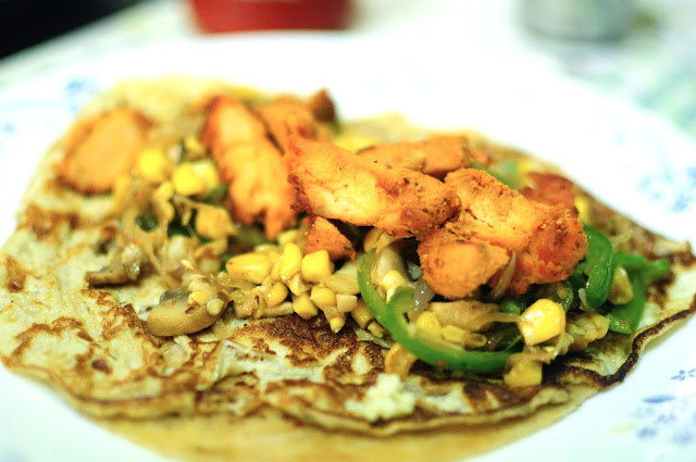 Pile high with the sauteed veggies and pieces of the chicken kababs.