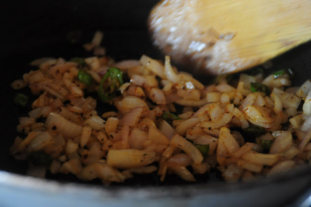 2. Stir fry the onions, garlic, red chili flakes, green chilies, and herbs.