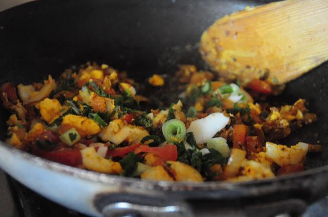7. Add a garnish of spring onions and fresh cilantro.