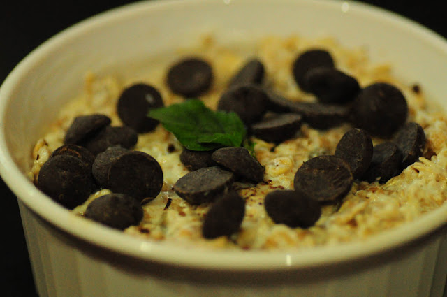 Decorate with some more bittersweet chocolate chips and a sprig of basil/ tulsi.