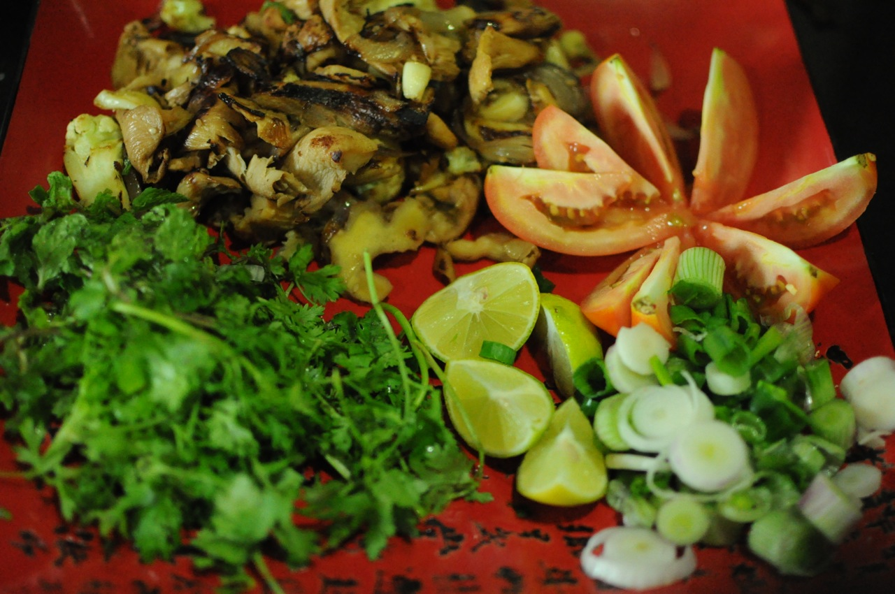 Oyster mushroom saute, sliced tomato, sliced spring onions, quartered limes, a mix of fresh coriander and mint leaves