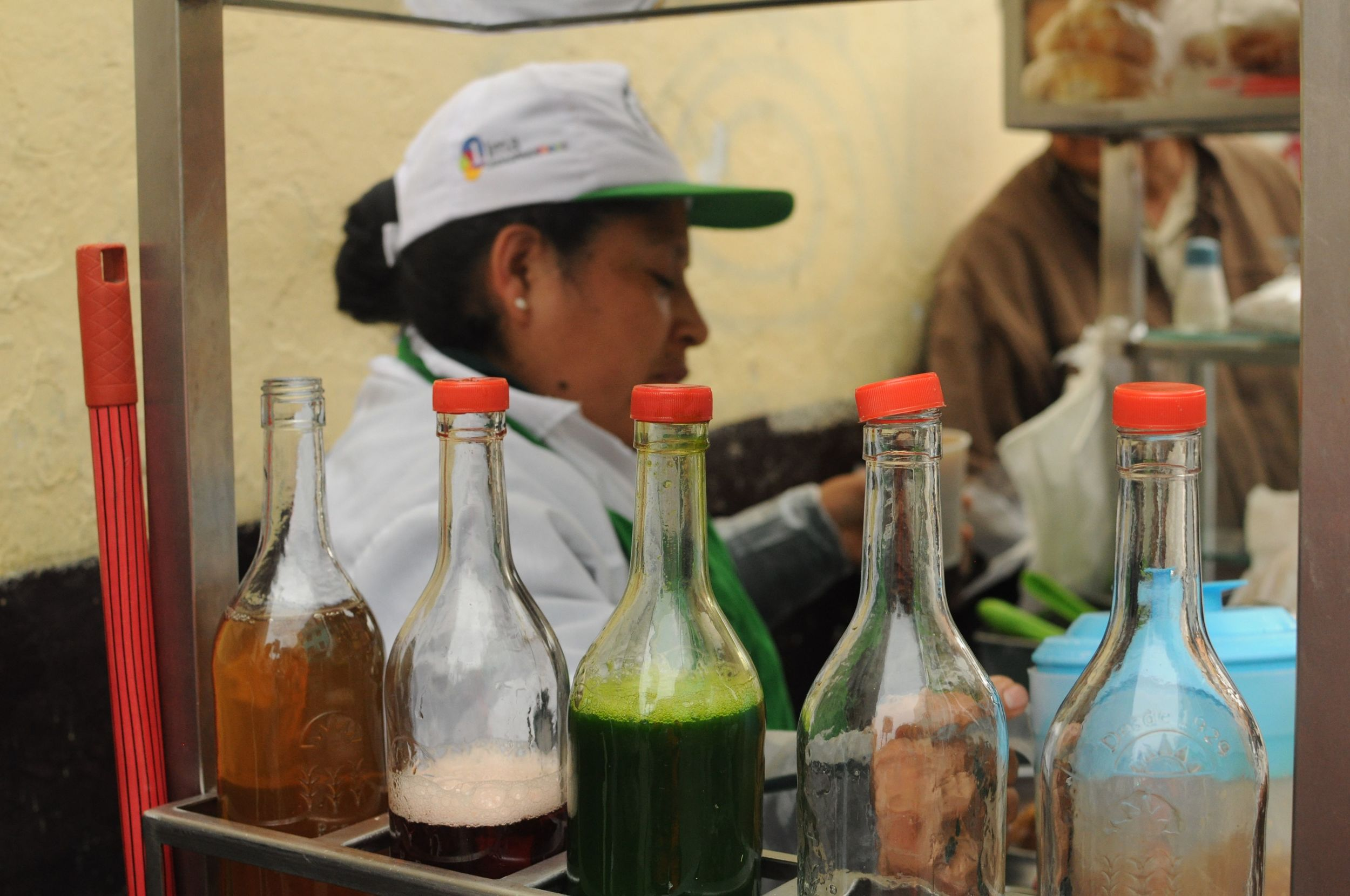 The lady making strange drinks with colourful syrups. Unlike gola these were served hot!