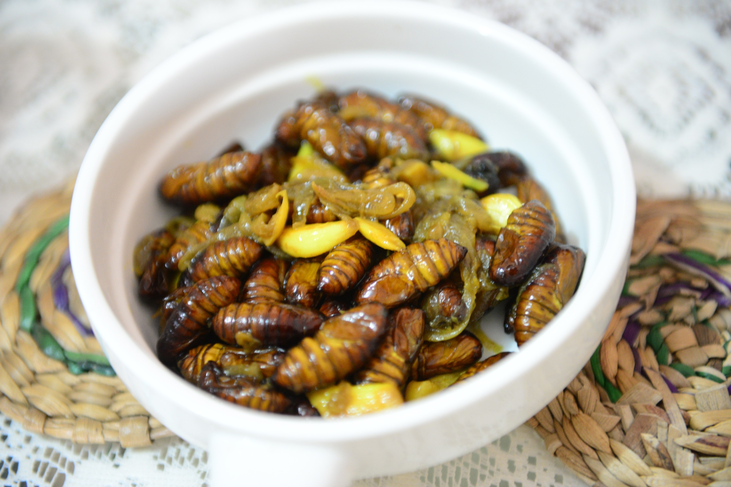 New harvest silkworms cooked with onions and garlic