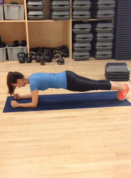 My bad on the camera angle, but Stephanie showing us how to do a basic forearm plank.