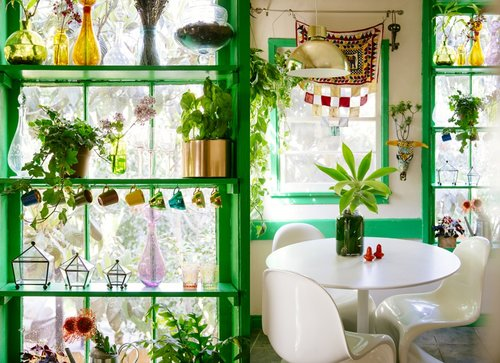 Justina Blakeney design - a kitchen with lots of bright green accents