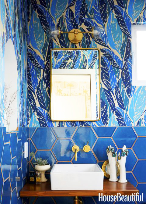 Photo by David Tsay for House Beautiful Magazine. Design by Justina Blakeney. Blue bathroom with half hexagonal tile, half leaf-patterned tile.