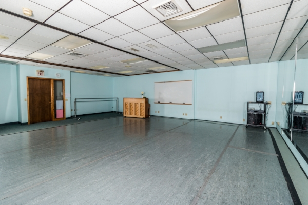 Studios 3  24' x 27' dance space with professional grade sprung wood floors, Marley dance floor covering, full-length glassless safety mirrors, an upright piano, and full sound system.