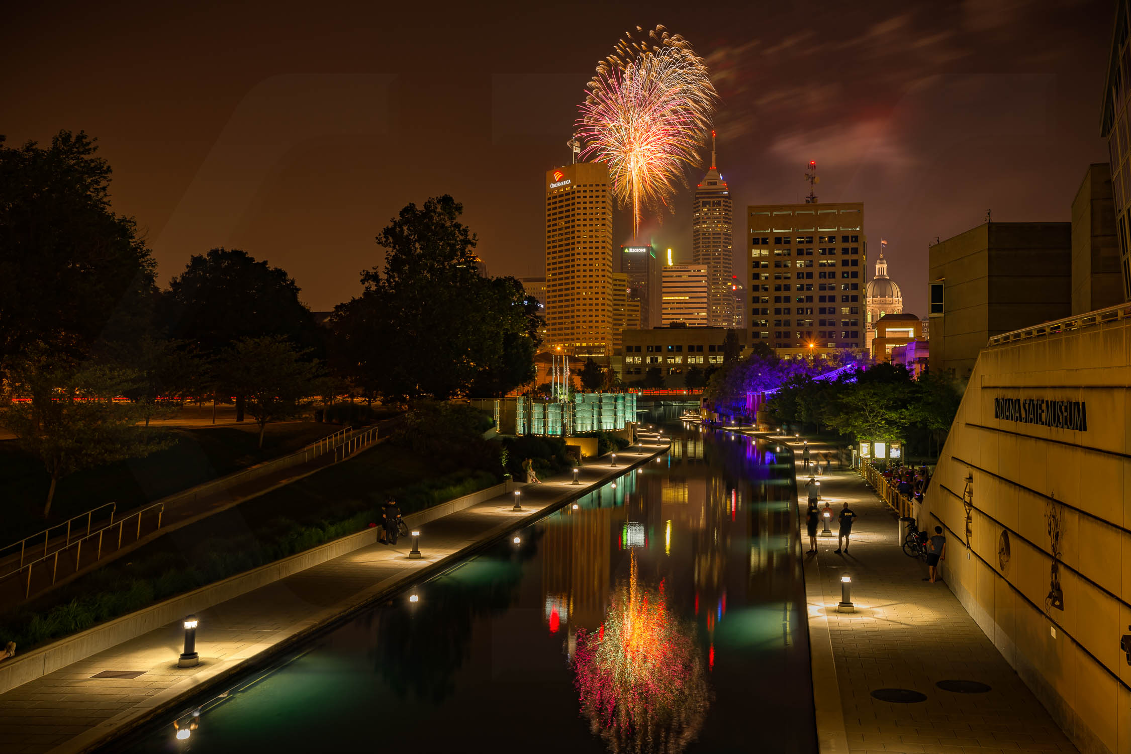 "4th of July Fireworks in Indianapolis Indiana over the White River Canal.  (Image is lightly watermarked w/ my ""CX"".)"