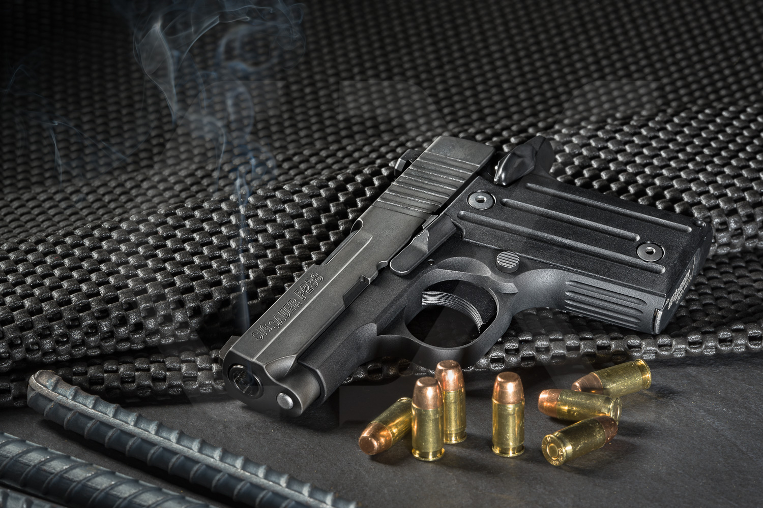 Sig Sauer P238 smoking gun with ammo