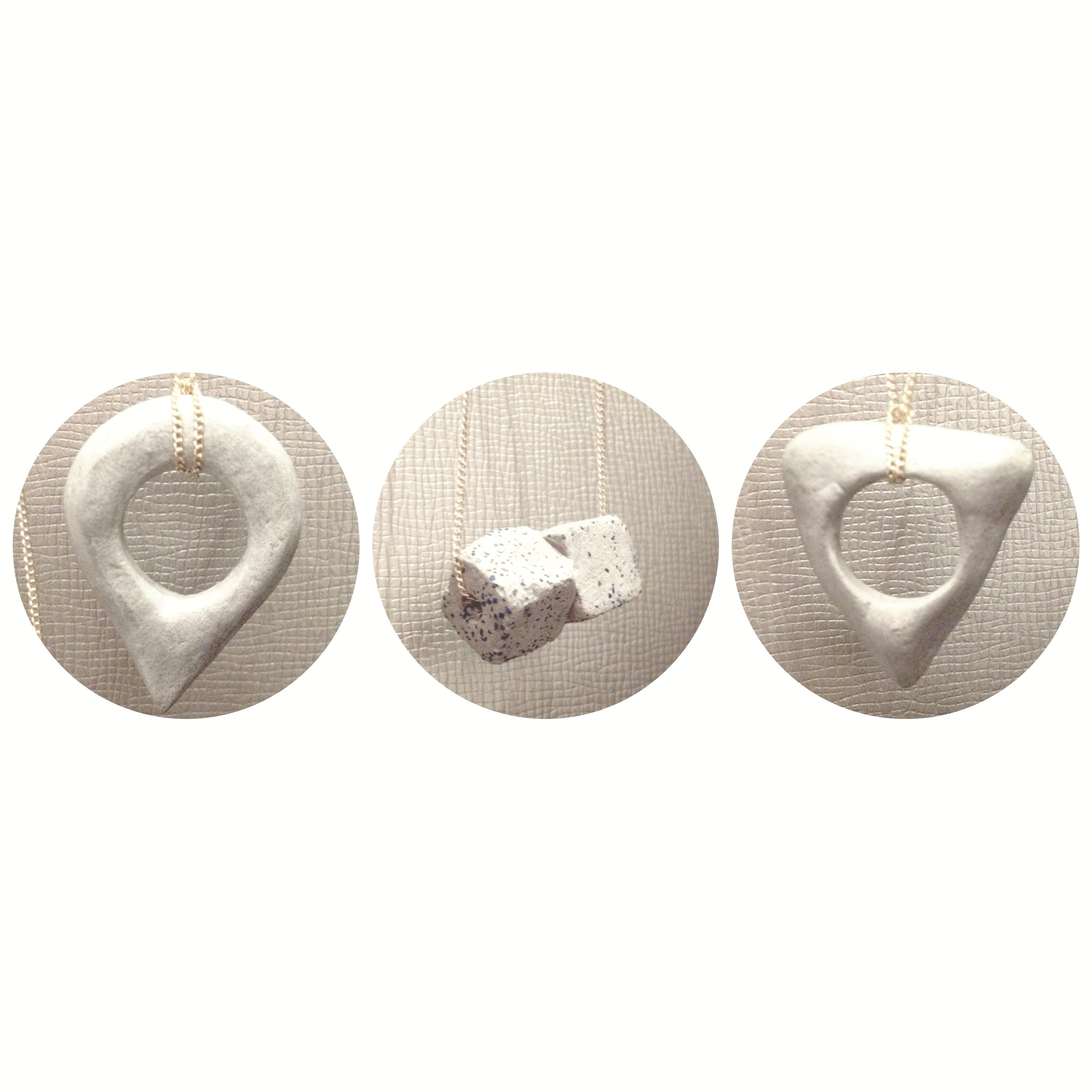 Our newest concrete pendants.From left:  You Are Here ,  Cubic Kiss , &  Ouija  necklaces.