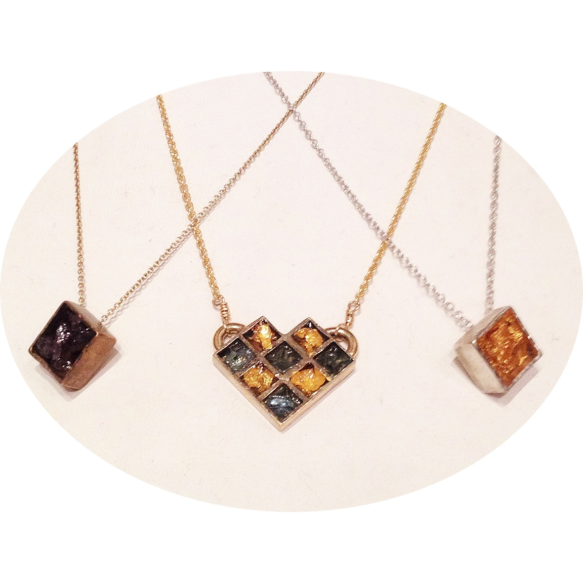 Signature resin pieces spawned the new Honeycomb Series (center). From left: bronze with crushed amethyst, bronze honeycomb with 24-karat gold leaf & crushed green glass, sterling silver with 24-karat gold leaf.