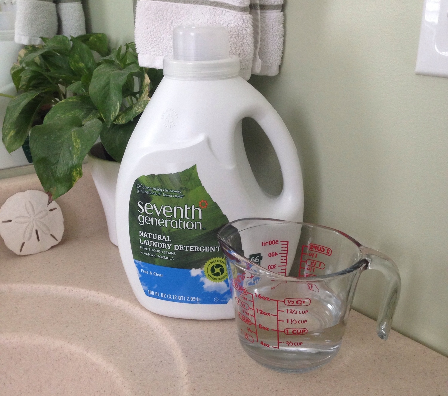 To clean your shower curtain liner all you need is white vinegar, laundry detergent, and a washing machine