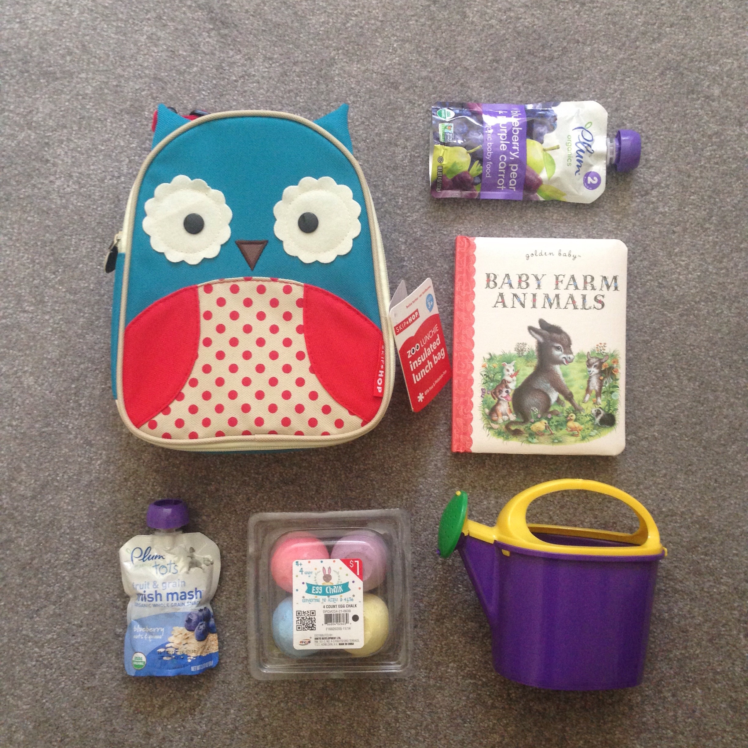 Toddler Easter Basket Ideas:  Lunch box, snacks, chalk, book, watering can