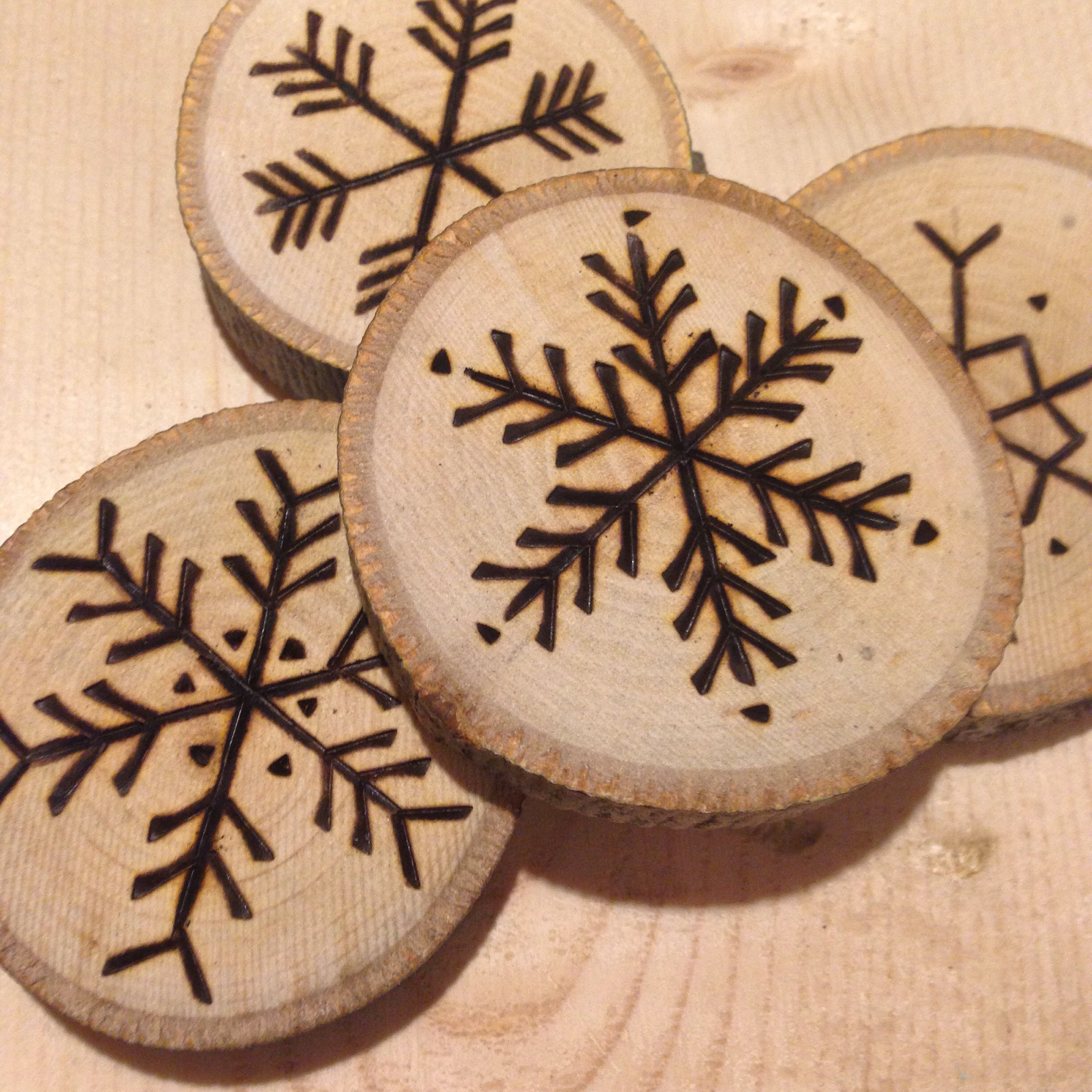 Hand-etched maple snowflake ornaments by Birch Landing Home