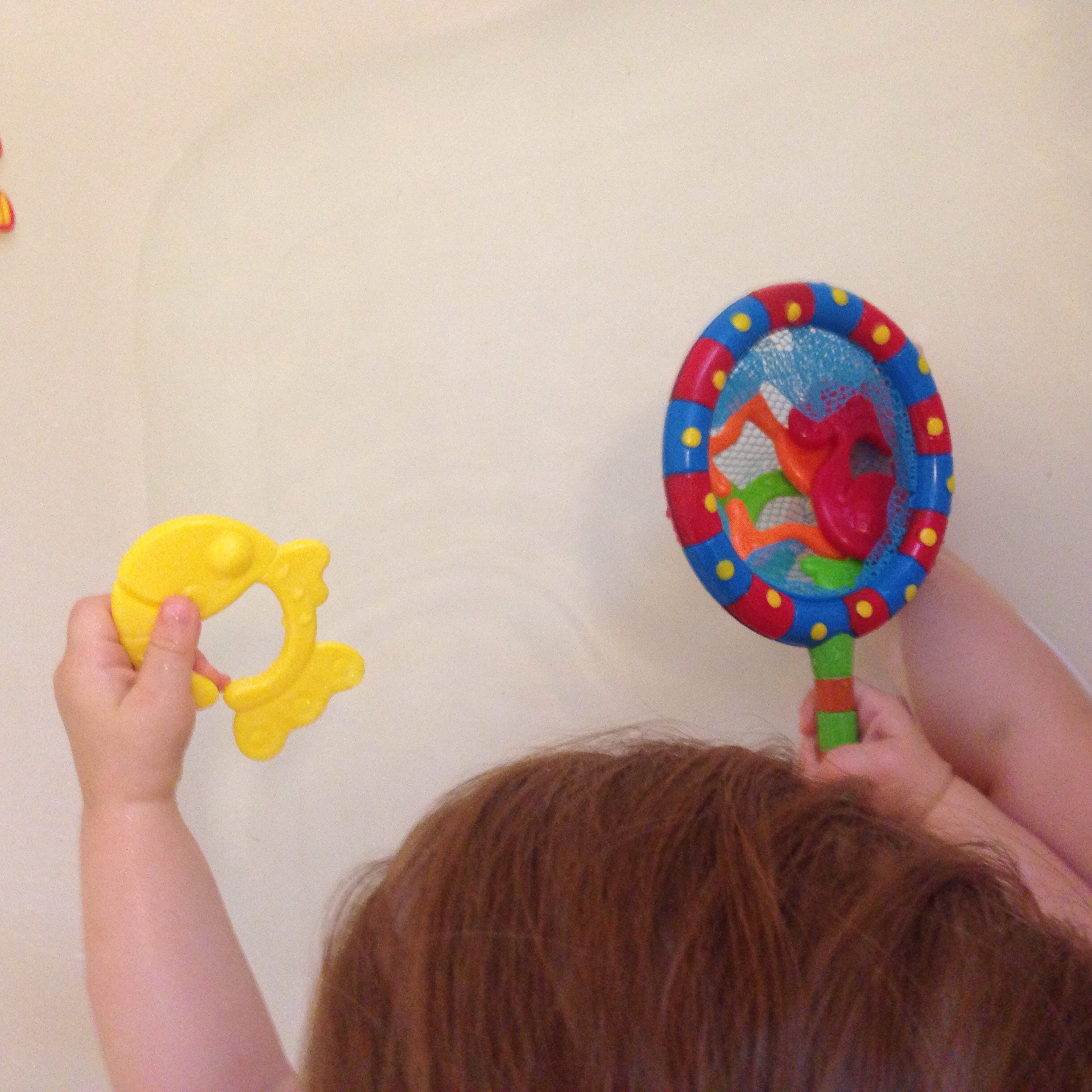 Playing with the Nuby Splash n' Catch Fishing Set in the tub