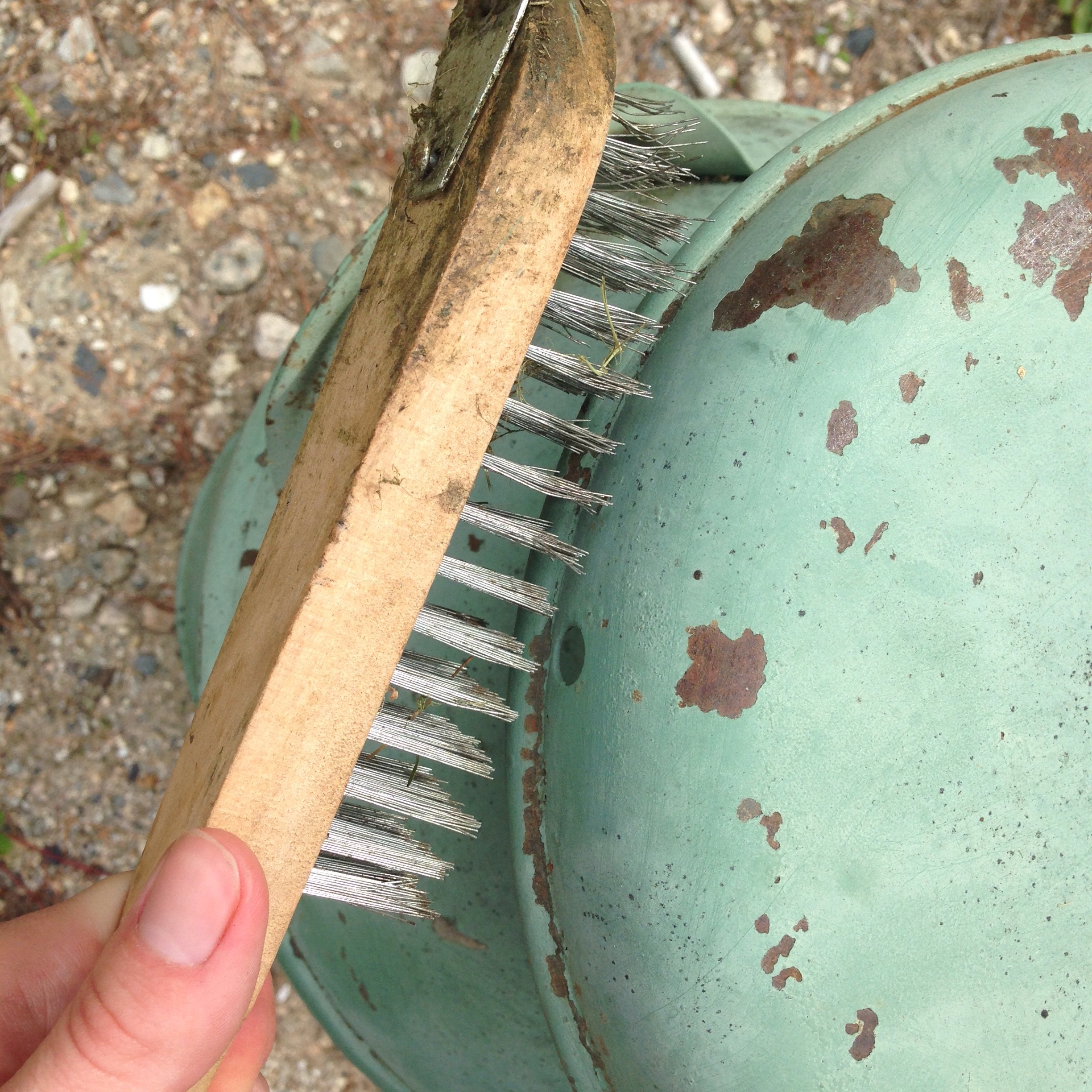 Remove loose rust and dirt with a wire brush