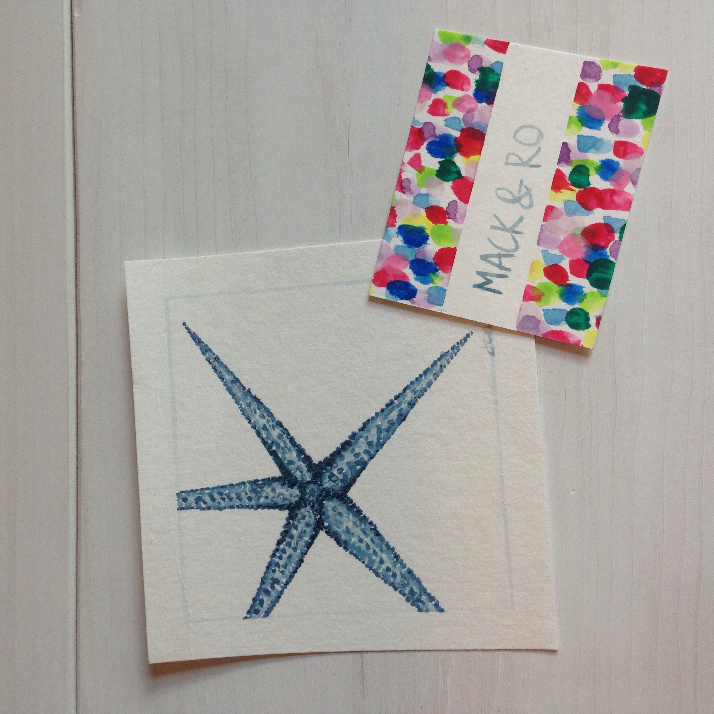 Watercolor starfish painting by Mack & Ro adds the perfect New England costal touch.