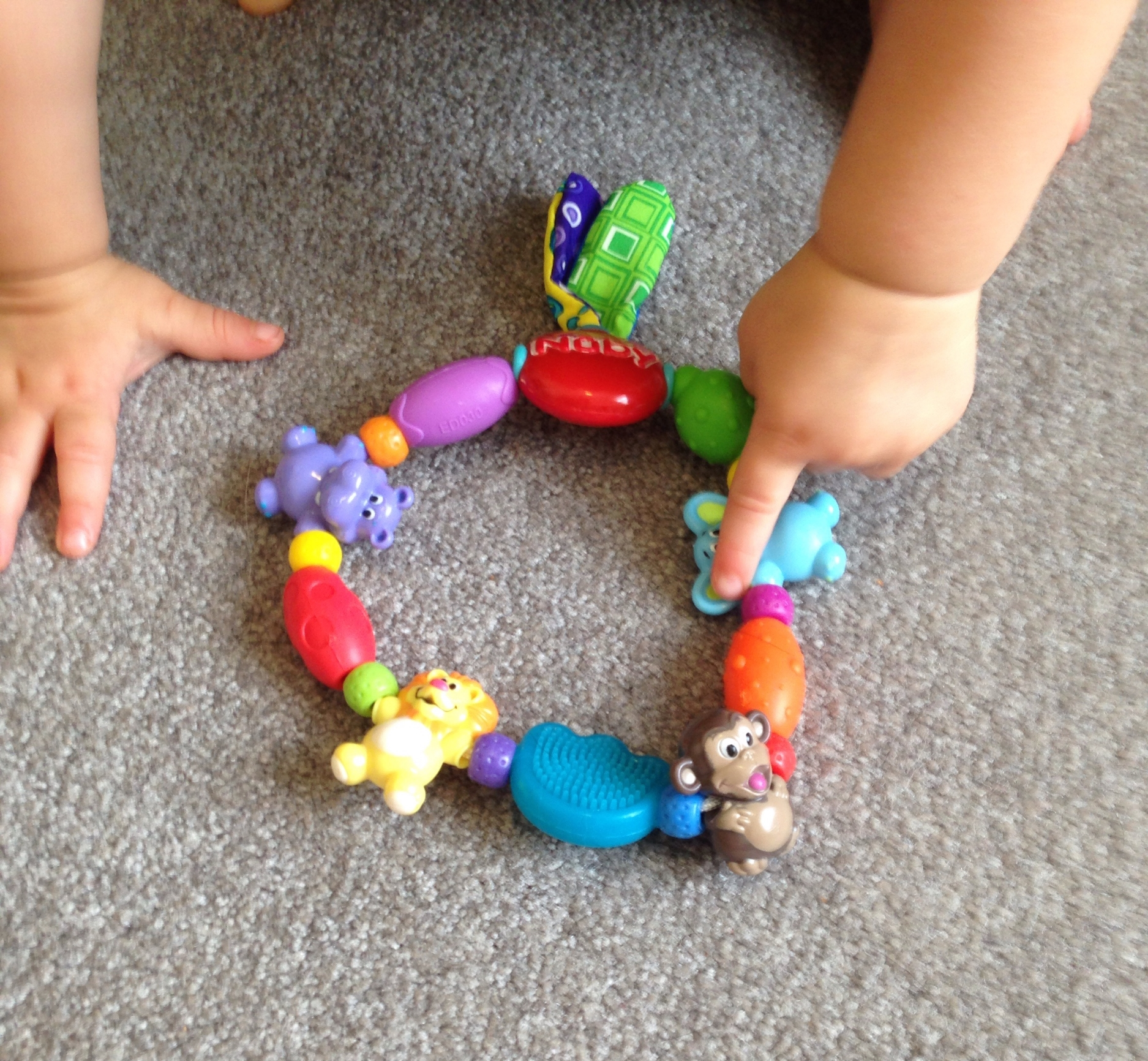 Pointing out the fun shapes on this Nuby teether