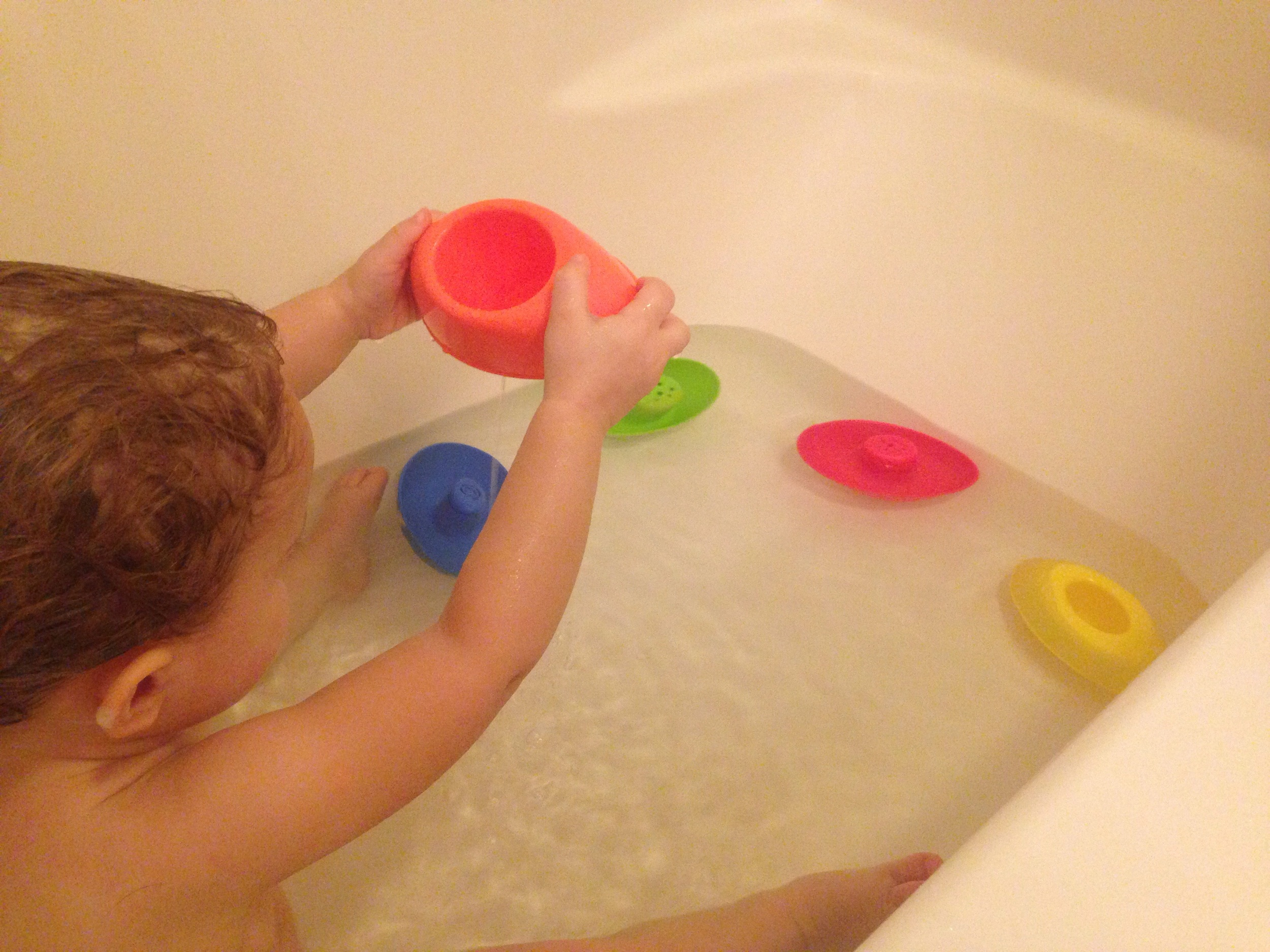 Playing with the Nuby bath boats