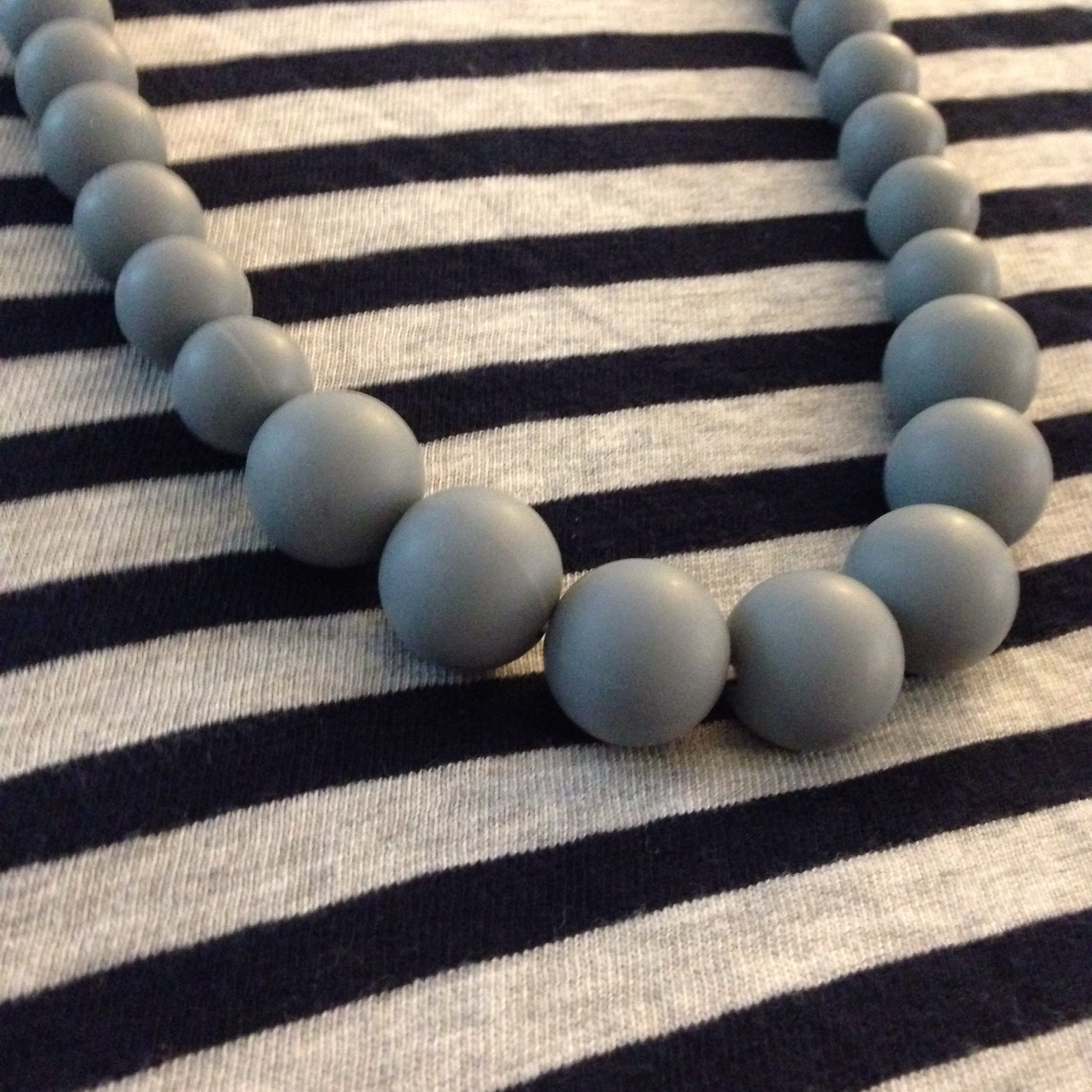 Just love the grey pearl beaded necklace against the grey and navy stripes!