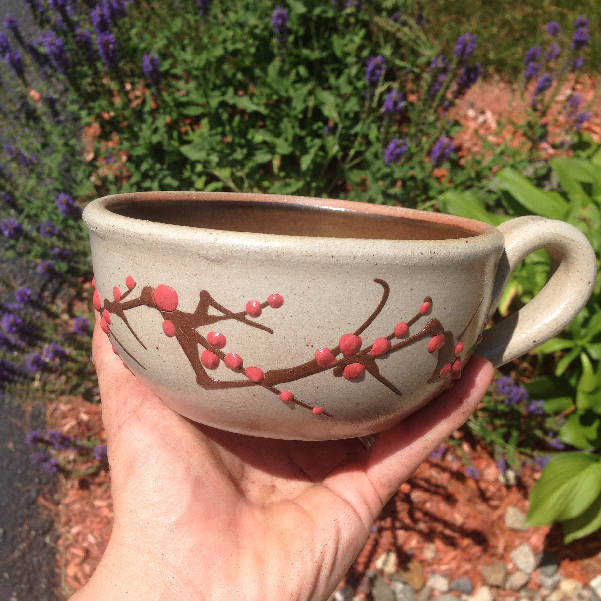 Repurpose a broken or chipped coffee mug into a kitchen herb garden
