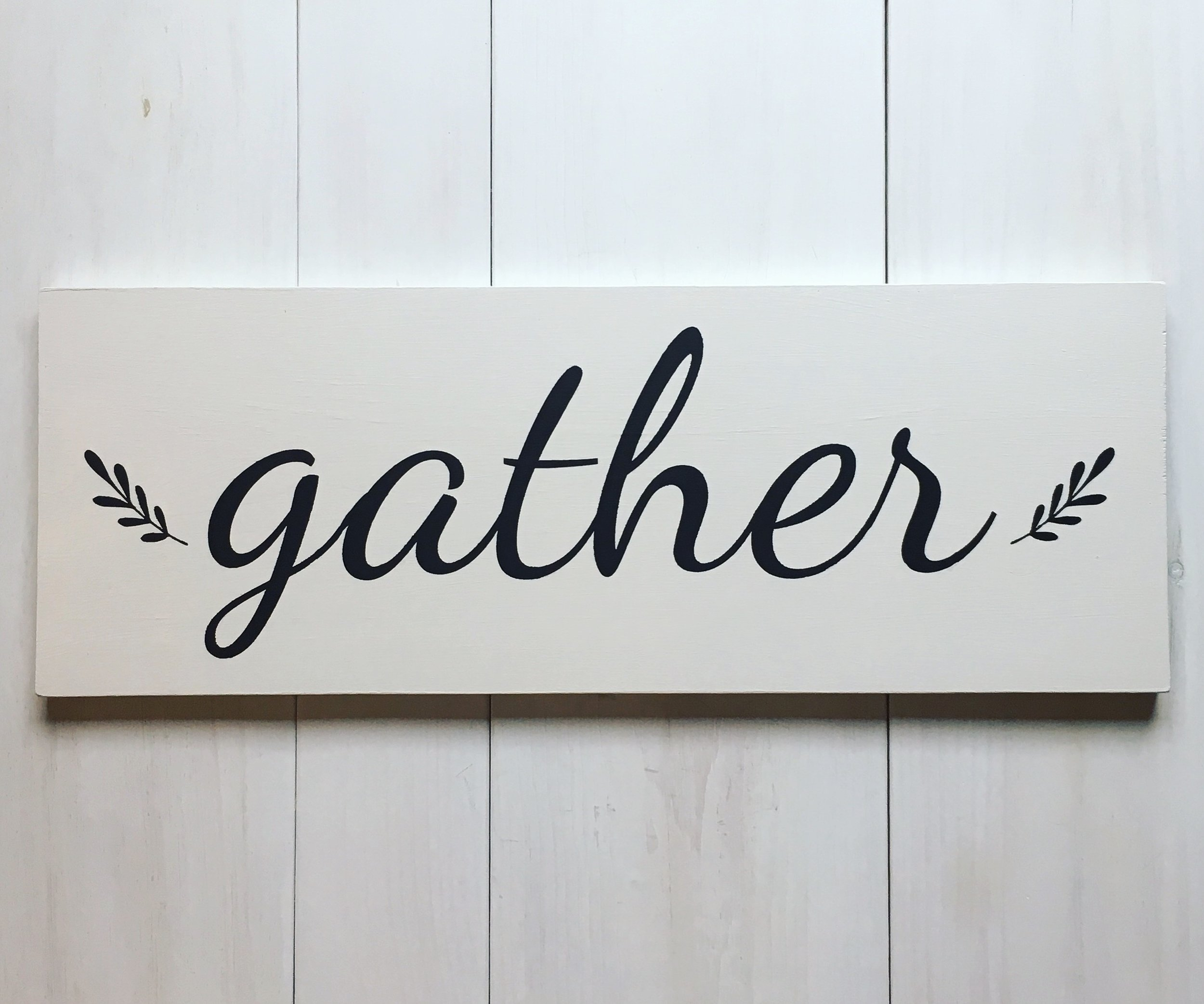 "Farmhouse-inspired ""gather"" sign by Birch Landing Home"