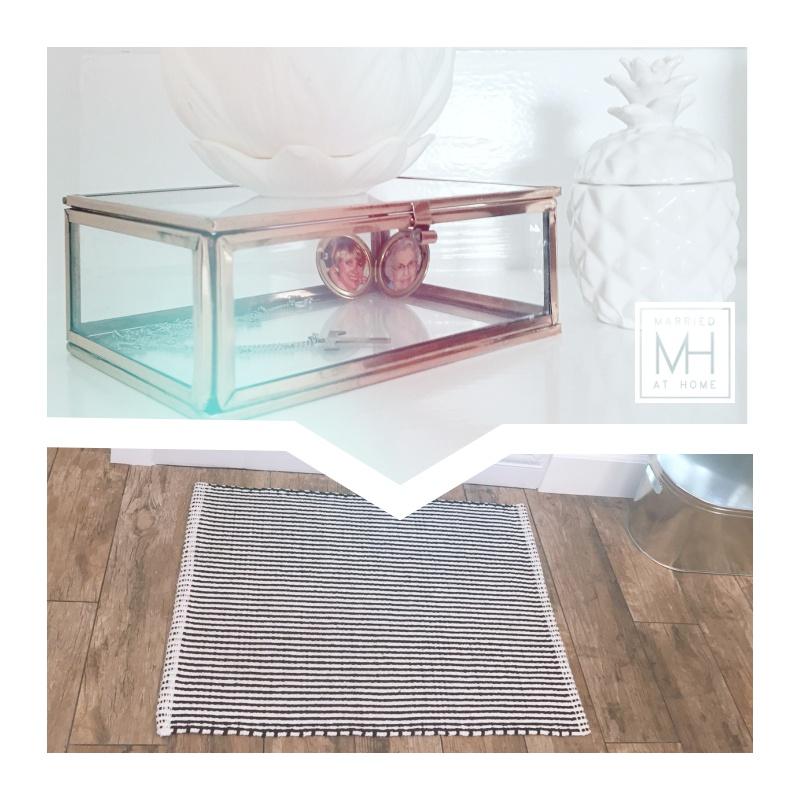 Copper + glass box, $14.95,  here  . Porcelain pineapple, similar  here  . Striped bath mat, $12.95,  here .