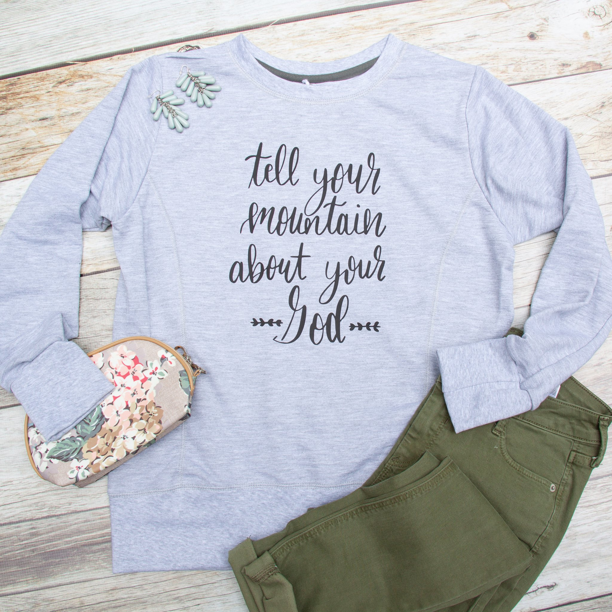 The fashionista will love this super soft french terry  Tell Your Mountain Sweatshirt  by Elly and Grace.