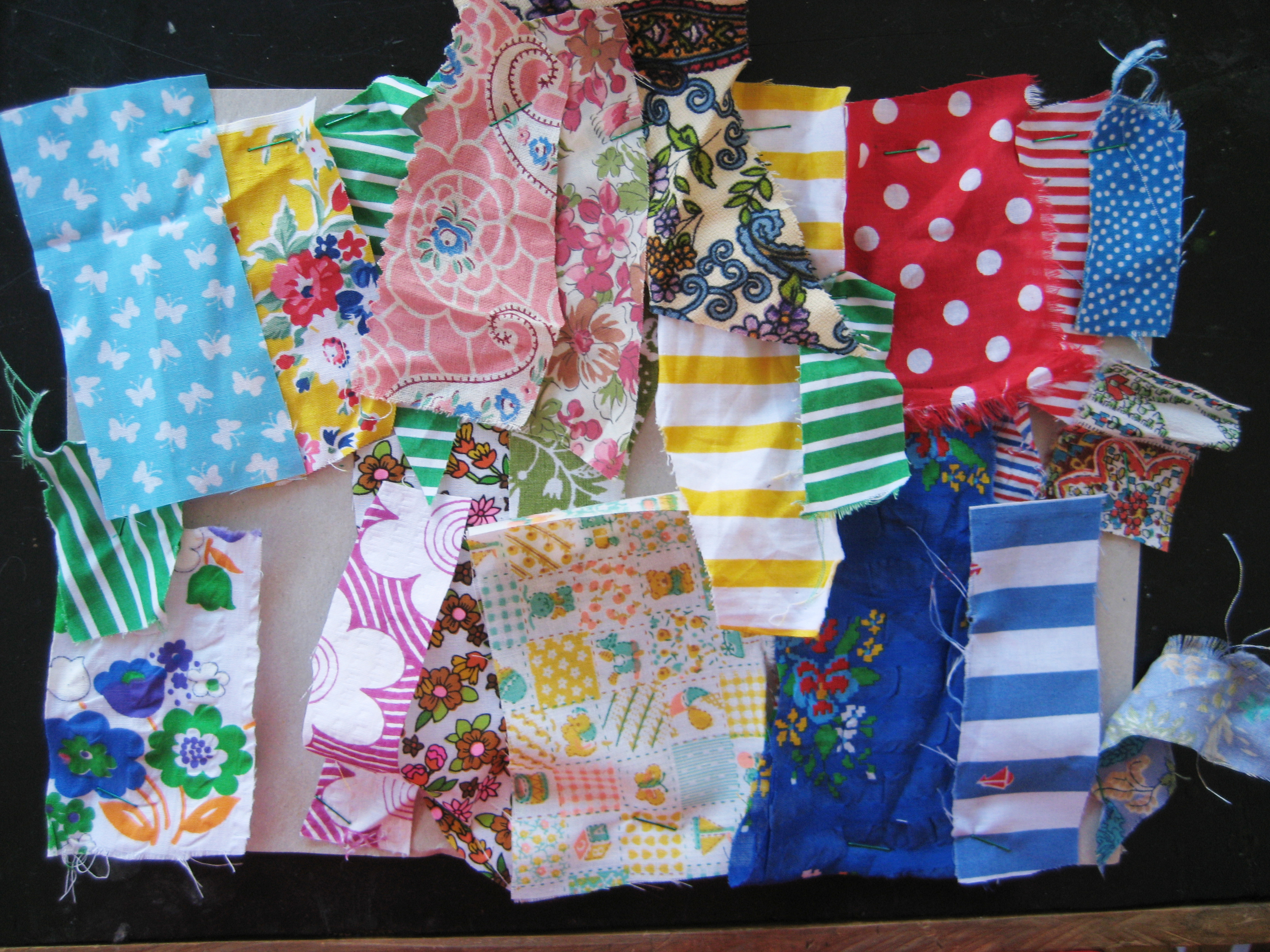 Summery cotton fabric samples for next year, already pinned to my workroom wall.