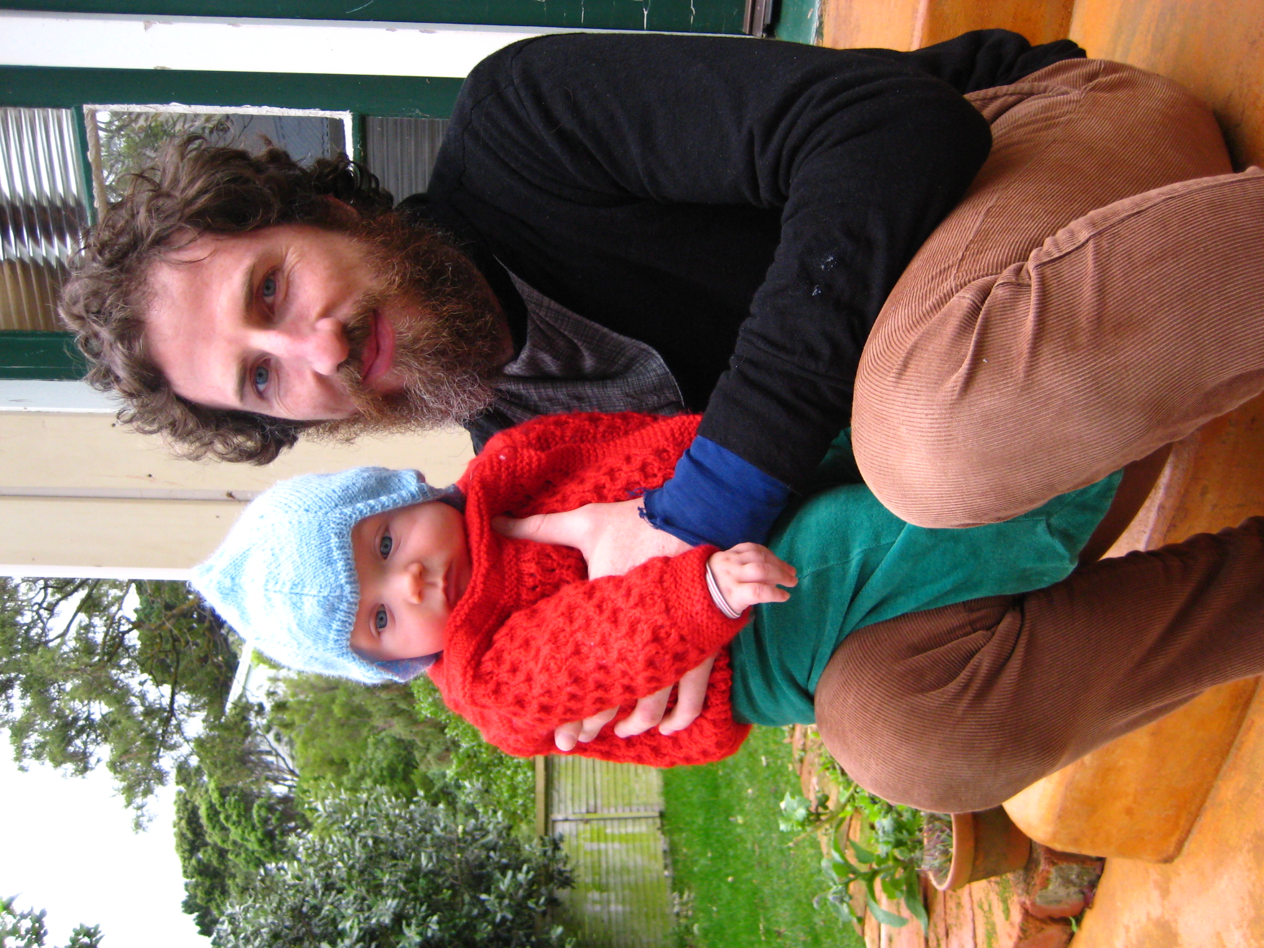 Op-shop-tastic: Home knits and green velor pants = part baby, part elf.