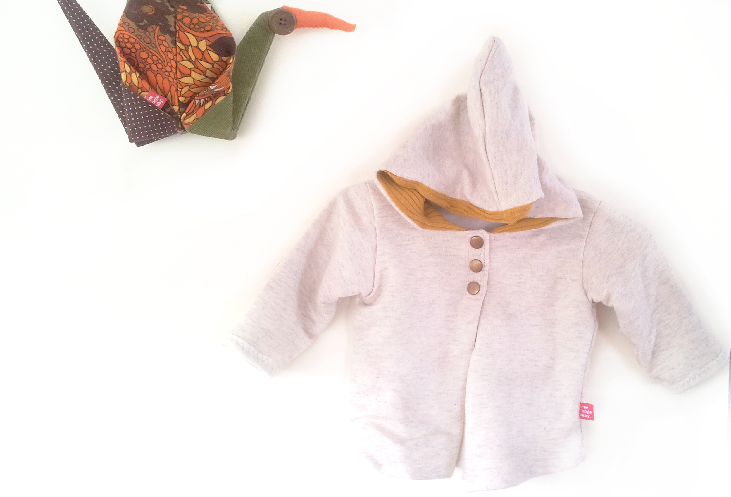 Organic cotton hoodie with mustard merino lining.