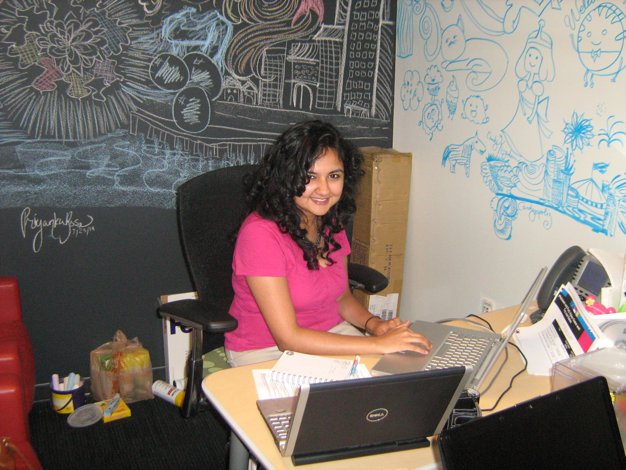 Me hard at work in my intern office at Cartoon Network! Behind me is a whiteboard wall and a chalkboard wall. All doodles are mine.