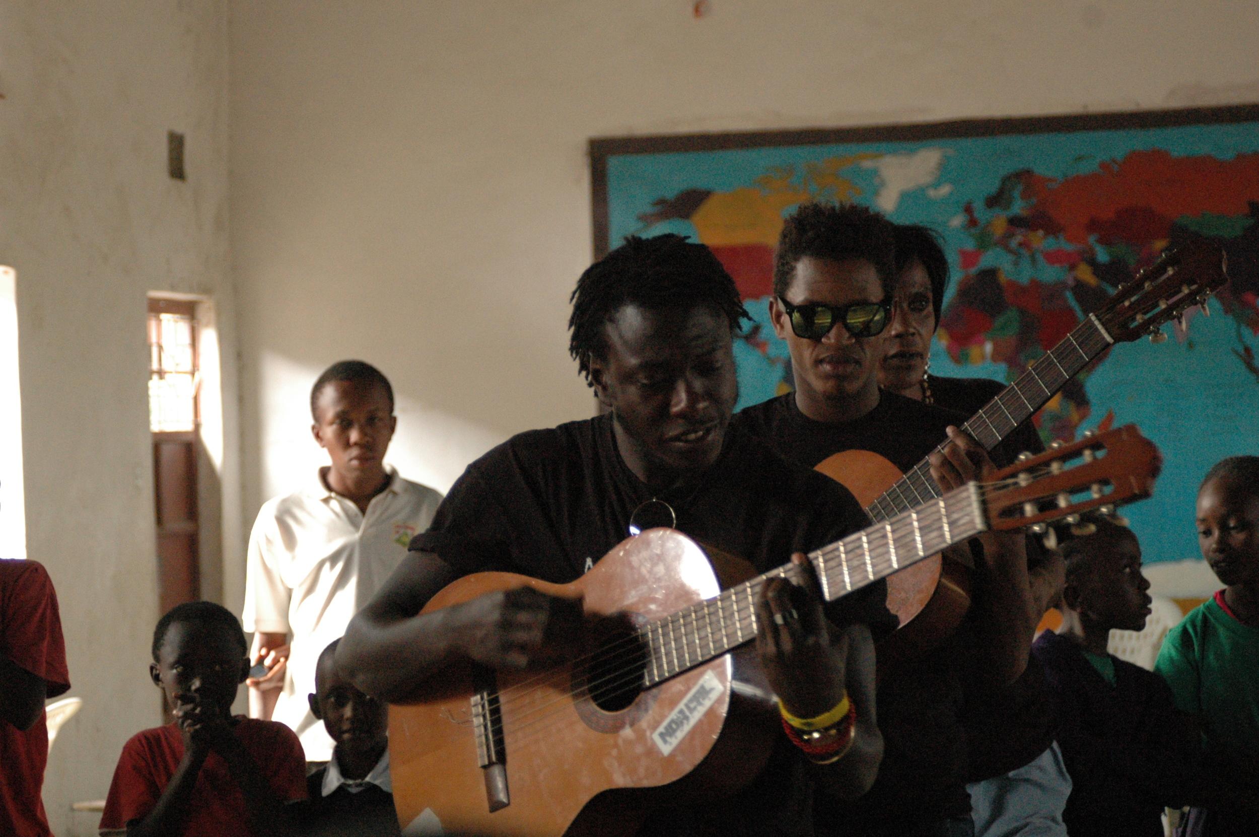 Music tecahers Mandela dn Mbau and dance teacher Comsolata.JPG