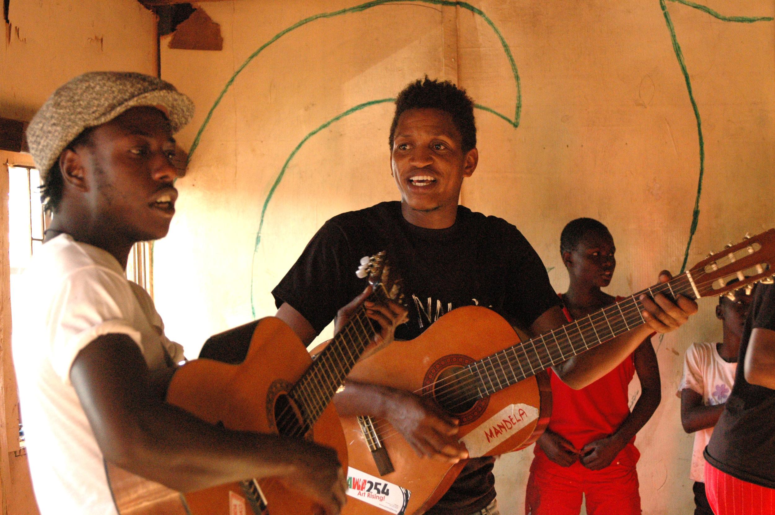 Music teachers Mandela and Mbau.JPG