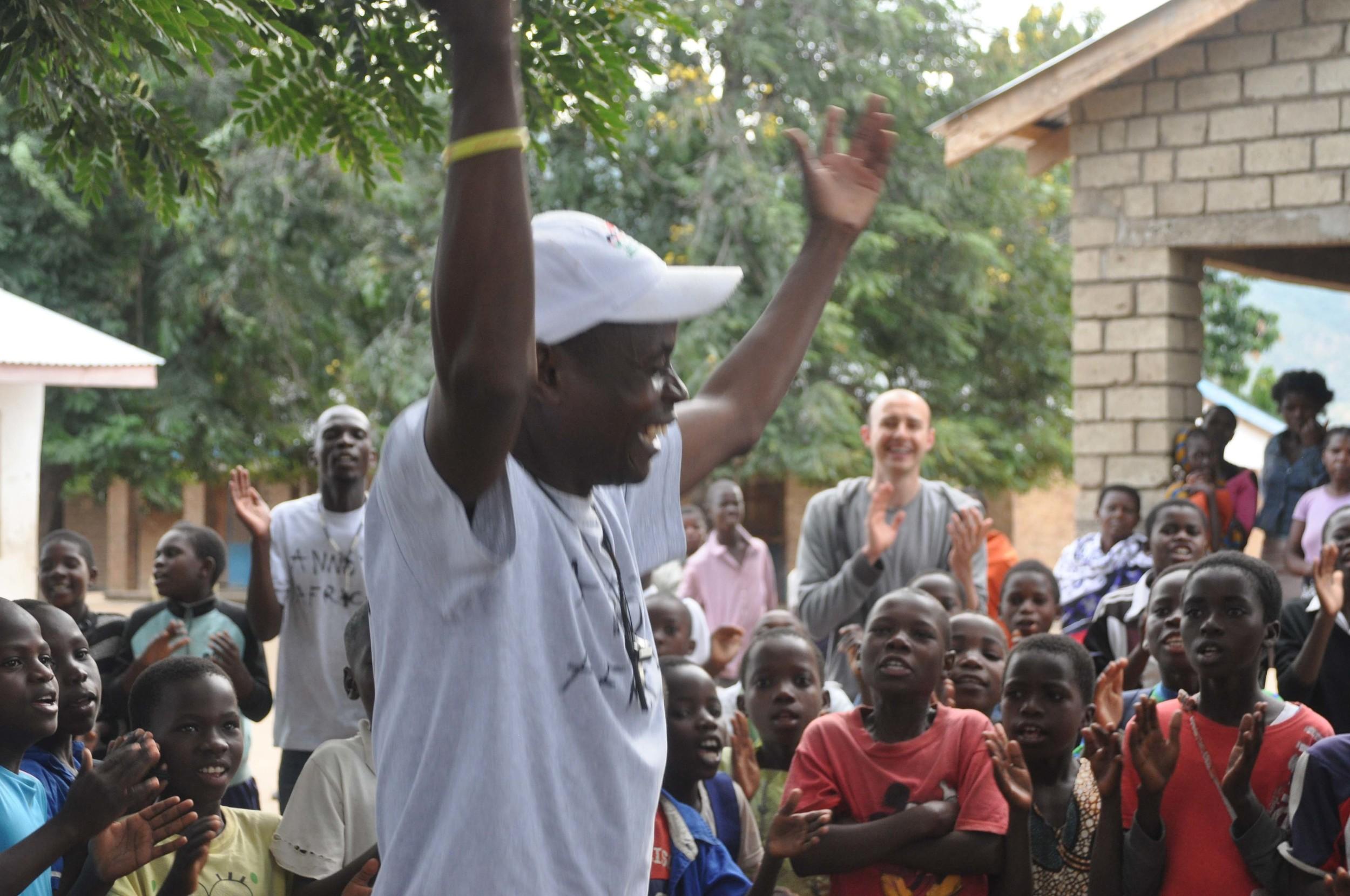 Teacher Emmanuel  leading warm up.jpg