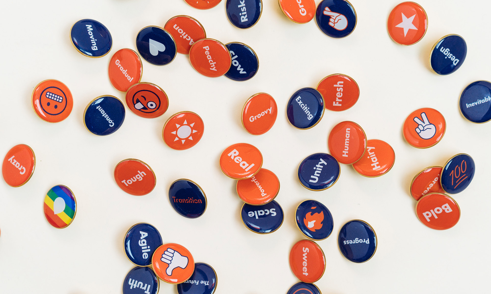 Pins with words and custom designed emojis for attendees to express their feelings about change