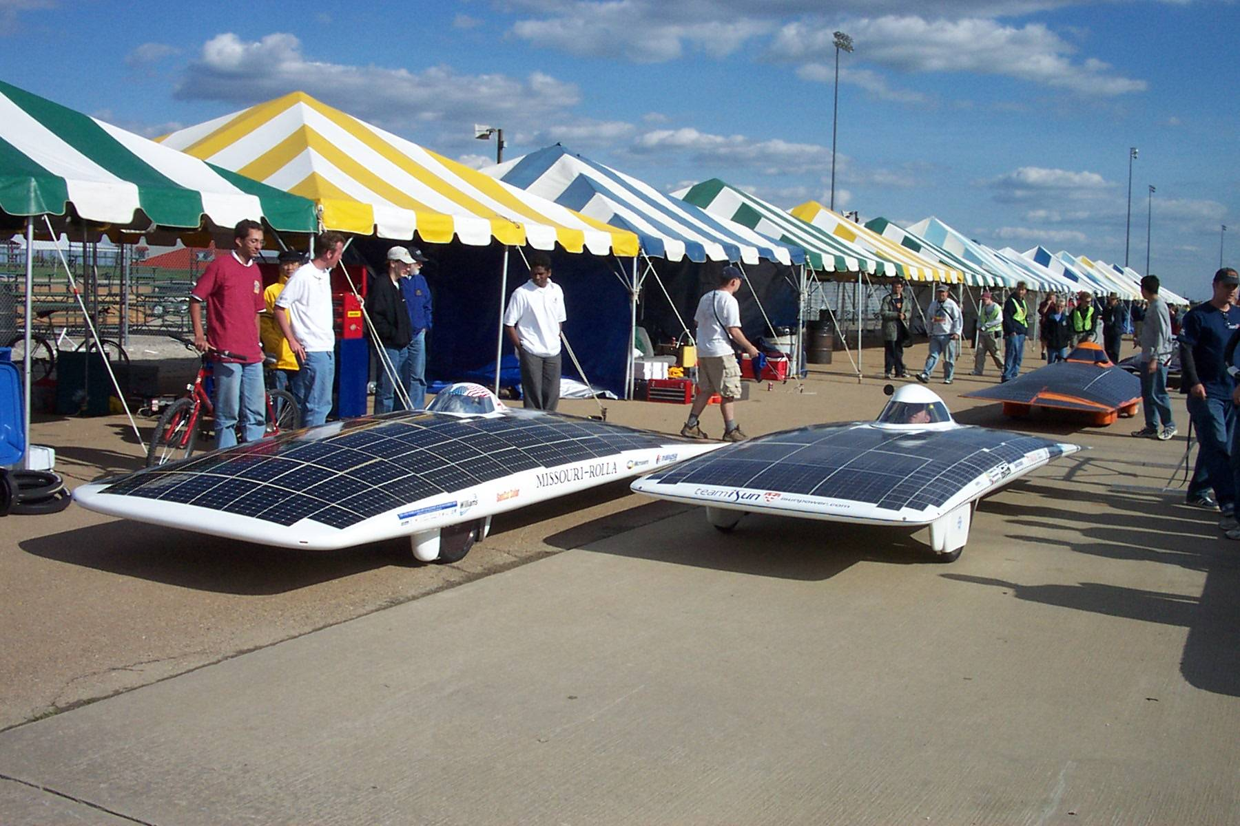 The iSun solar car on the right next to the car from Missouri-Rolla on the left.