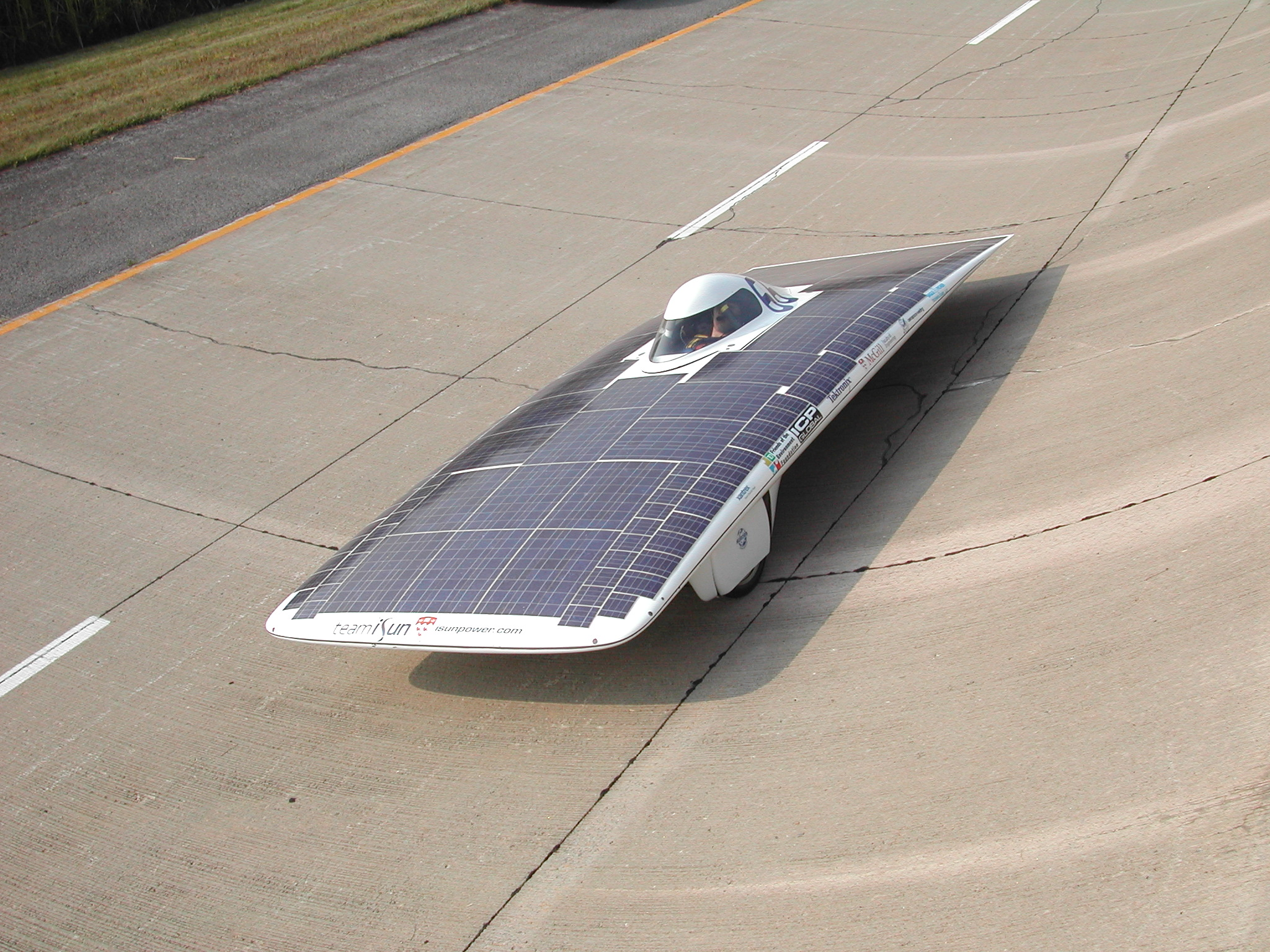 The iSun solar car prepping for the 2002 Formula Sun Grand Prix on the Canadian government test track outside Montreal Quebec Canada in 2002.