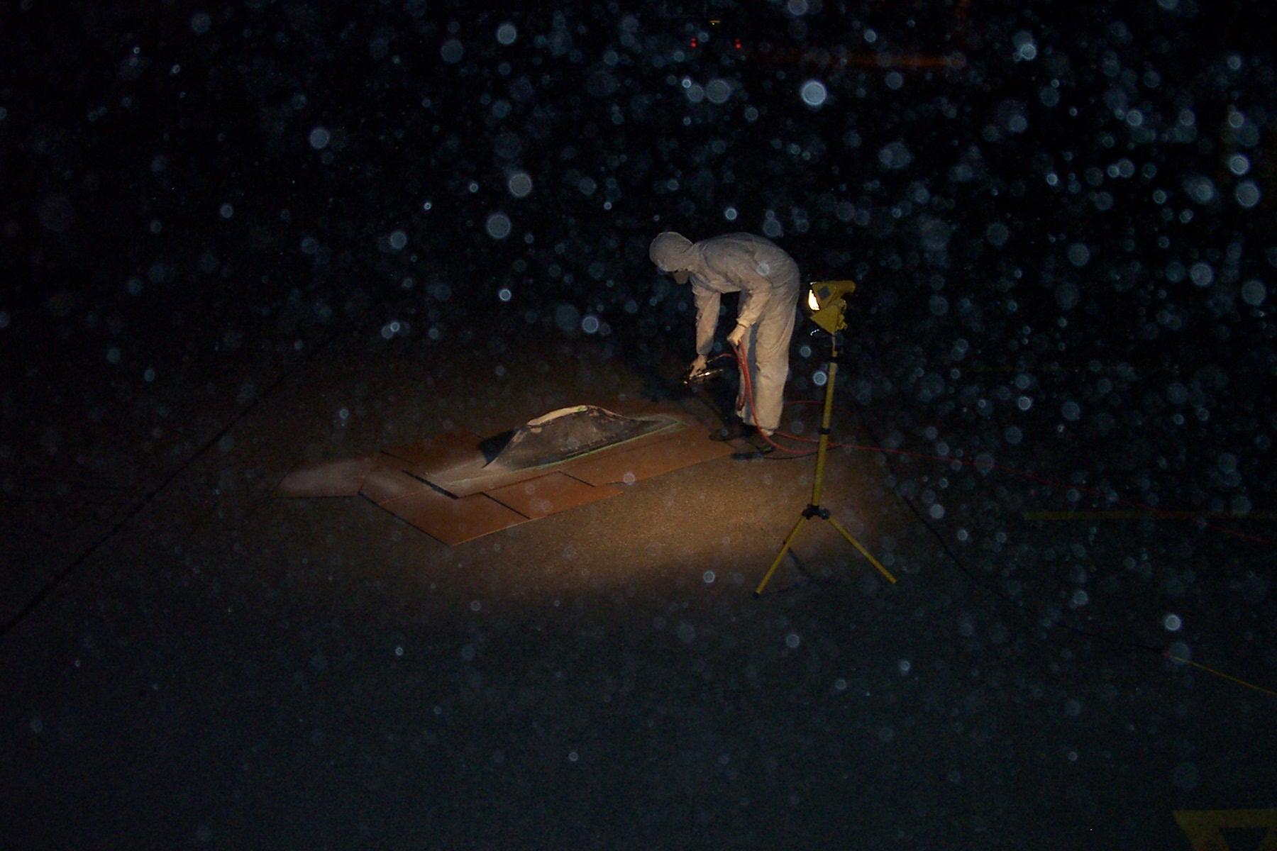 mathieu painting rear fairing outside of mech labs.jpg