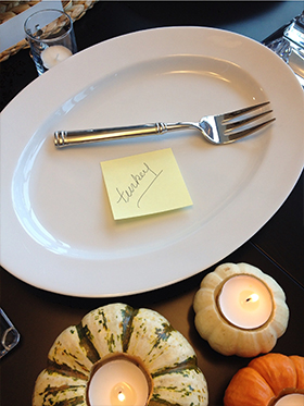"""Laying out my serving platters and bowls is essential to staying organized and making sure everything fits on the table. I like to mark each serving piece with a sticky note, making it easy to remember what goes where. It's also handy because guests can assist you in placing items onto the table. They will not have to second-guess if they are grabbing the correct """"big white bowl"""" as you shout from the kitchen (chances are there are more than one)!"""