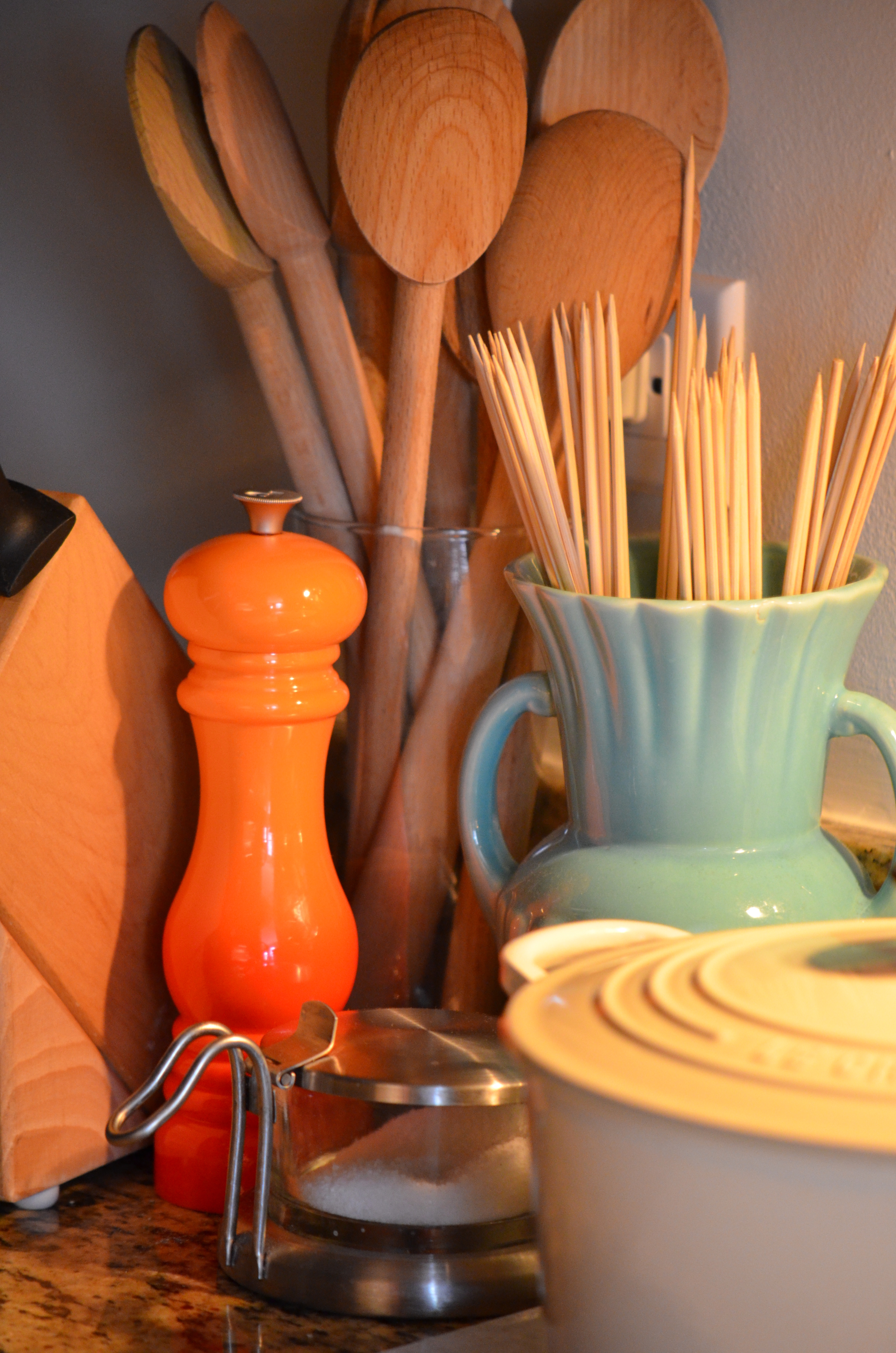 "A pop of color in the kitchen!  Even a simple orange pepper grinder is a fun and easy way to help your counter look ""dressed"" for Fall!"