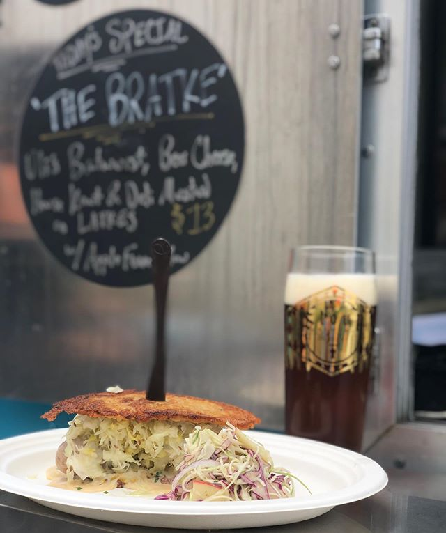 Happy Oktoberfest Friends! 🍺 We're here at @stoupbrewing serving up everyone's favorite: THE BRATKE! It's made with @ulissausage Brat, Beer cheese, house kraut and deli mustard on latkes. Served with an apple fennel slaw. See you soon. 😉 🍻