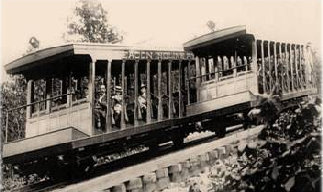"""1905: Cars passing one another on the """"Brown Patent Turn-out,"""" which eliminated the need for mechanical switching and allowed both cars to run simultaneously on a single track. The railway had a """"2-4-2"""" track configuration: two rails for most of the run, four rails at the turn-out.    Courtesy Beacon Historical Society"""