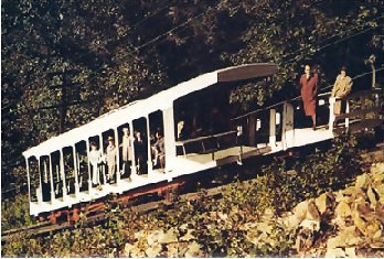 A rare color view of the cars passing on the turnout, circa 1950s. Notice that the summit-facing sides of each car was elongated, able to carry cargo and supplies to the mountaintop. The rear car was rebuilt without a roof after burning in 1936.