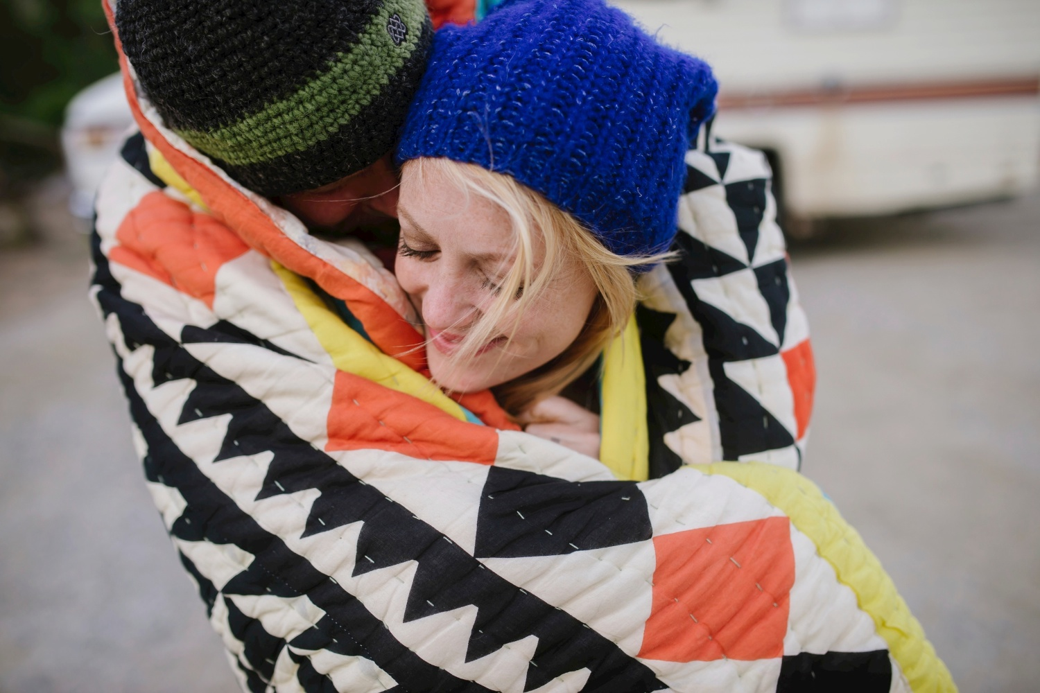 Love the romance of this sweet cuddle pose with a blanket // Adventure engagement photo shoot by Maddie Mae Photography